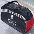 红黑广告旅行包